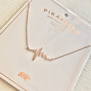 Tiny EKG Charm Necklace In Rose Gold on Gift Card