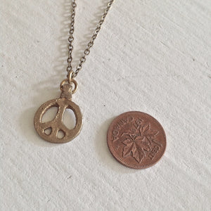Tiny rustic peace sign charm necklace in cast brass