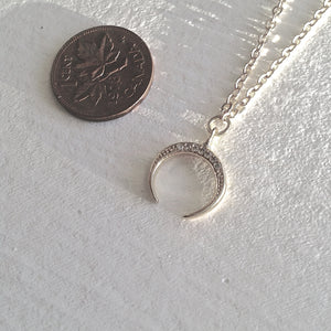 Pavé rhinestone studded tiny crescent horn charm necklace in silver