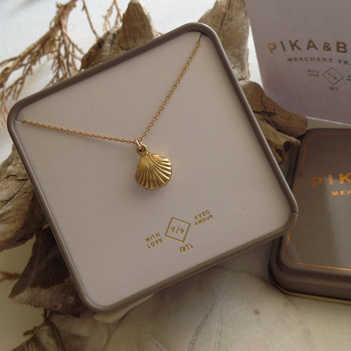 Gold Filled Tiny Seashell charm necklace on vermeil chain