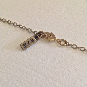 Pika & Bear Logo on brass chain with icepick clasp