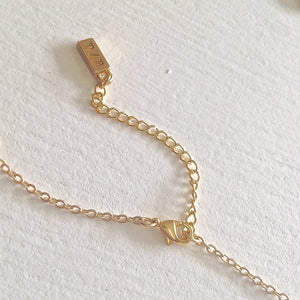 Gold extension chain with clasp.