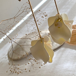 On trend fashion floral drop earrings in cream