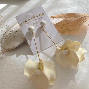 On trend fashion floral drop earrings in cream on gift card