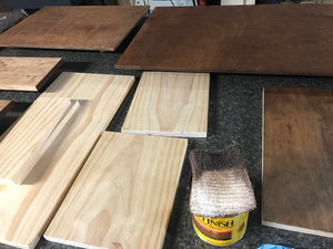 Wood boards being stained for engraved signs - Woodbott