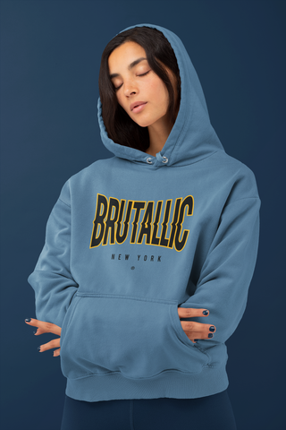 Indigo blue hoodie with disrupted brutallic front logo, worn by female model with hands tucked inside front pouch pocket