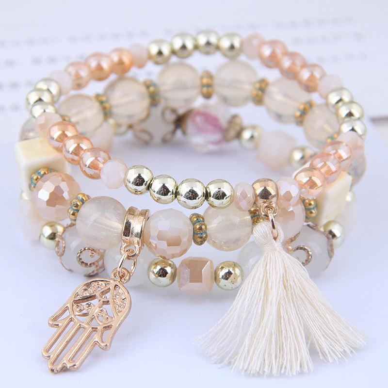Tassel & Palms layer bracelets