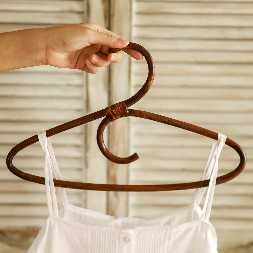 Vintage-inspired clothing rattan hangers handmade in the Philippines.