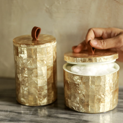 Elevate the look of your bathroom counter with the Sienna Capiz Bathroom Canister Set of 2. Meticulously handmade in the Philippines.