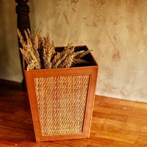 Our trash bin adds a natural touch to your bathroom while keeping it clean at all times.  Made in the Philippines from woven rattan mat and faux leather material.