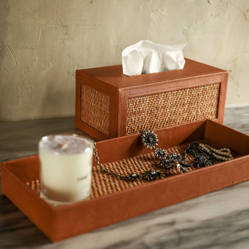 A set comes with a rectangular tissue box cover and a vanity tray that stores your essential toiletries and hand towels on your bathroom counter.  Made in the Philippines from woven rattan mat and faux leather material.