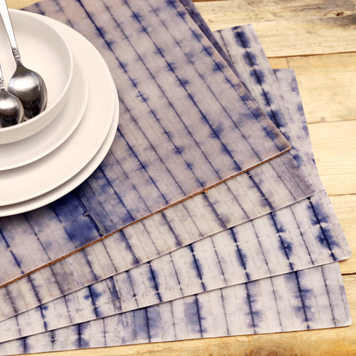 Add a dose of summer fun to your dining table with our shibori print placemats. Shibori tie-dyed paper is meticulously laminated with resin material in the Philippines. Available online.