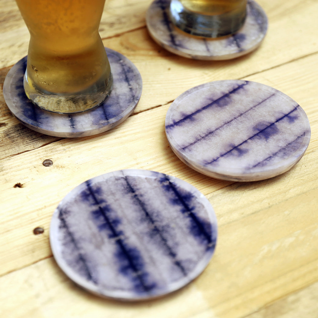 Add a dose of summer fun to your everyday dining with our shibori round coaster. Shibori tie-dyed paper is meticulously laminated with resin material in the Philippines. Available online.