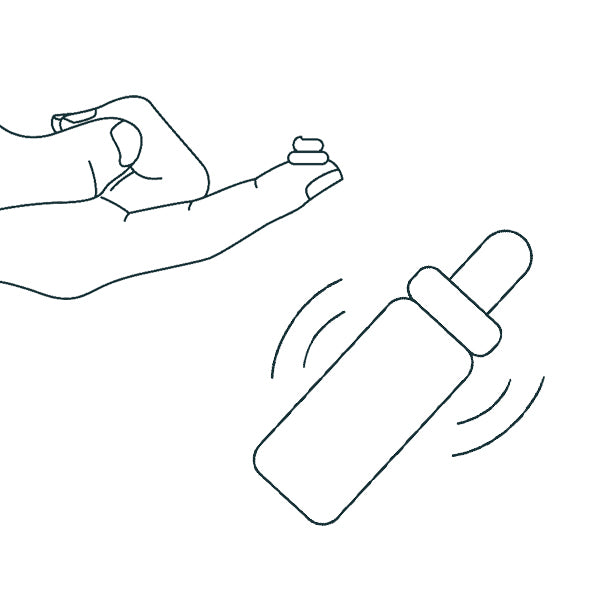 hand with a bit of salve on the finger and a bottle in a shaking motion