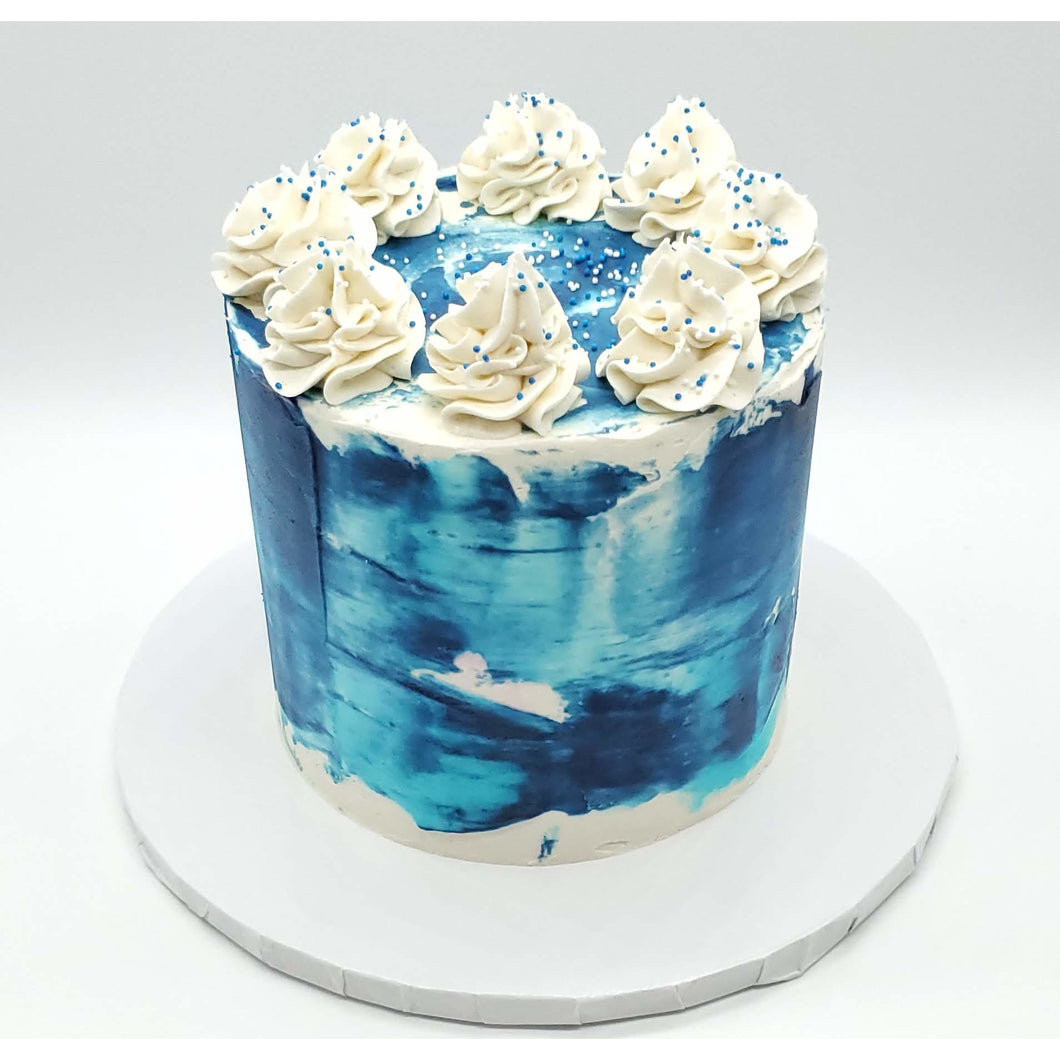 6 Inch Blue Tōn'd Cake with Frosting and Sprinkles on top