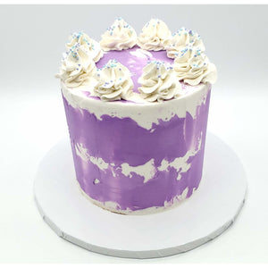 6 Inch Purple Tōn'd Cake with Frosting and Sprinkles on top