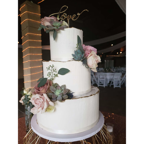 Three Tier Deckle-Edge Wedding Cake with Love Cake Topper and Floral Accents
