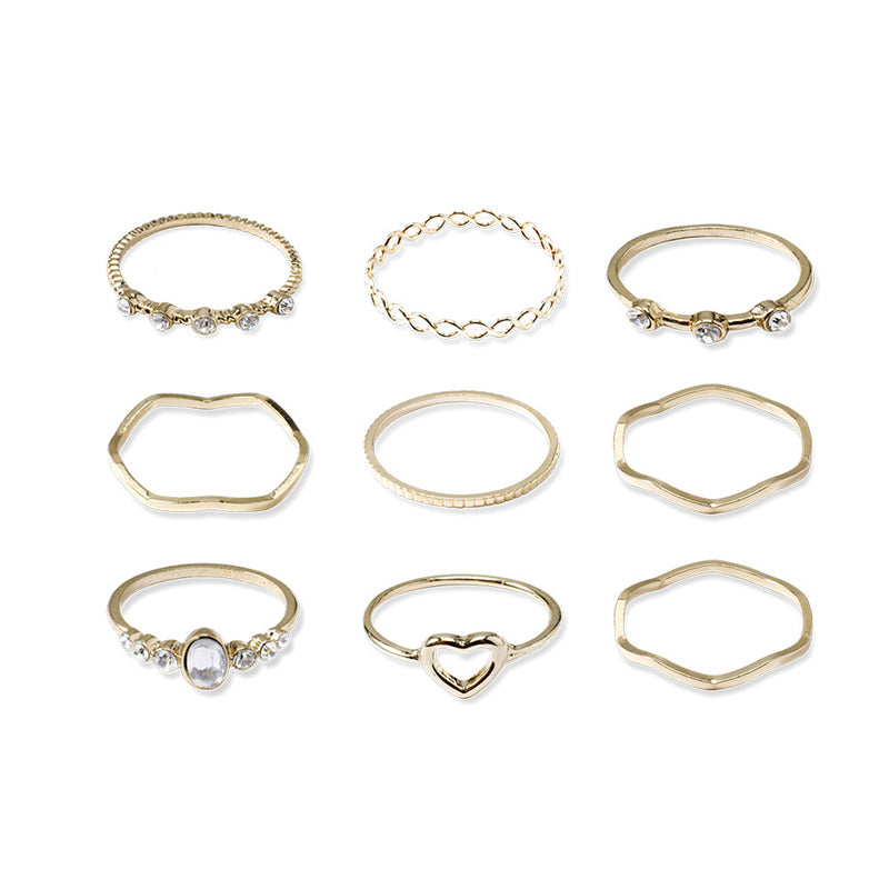 Simple openwork geometric love 9-piece ring