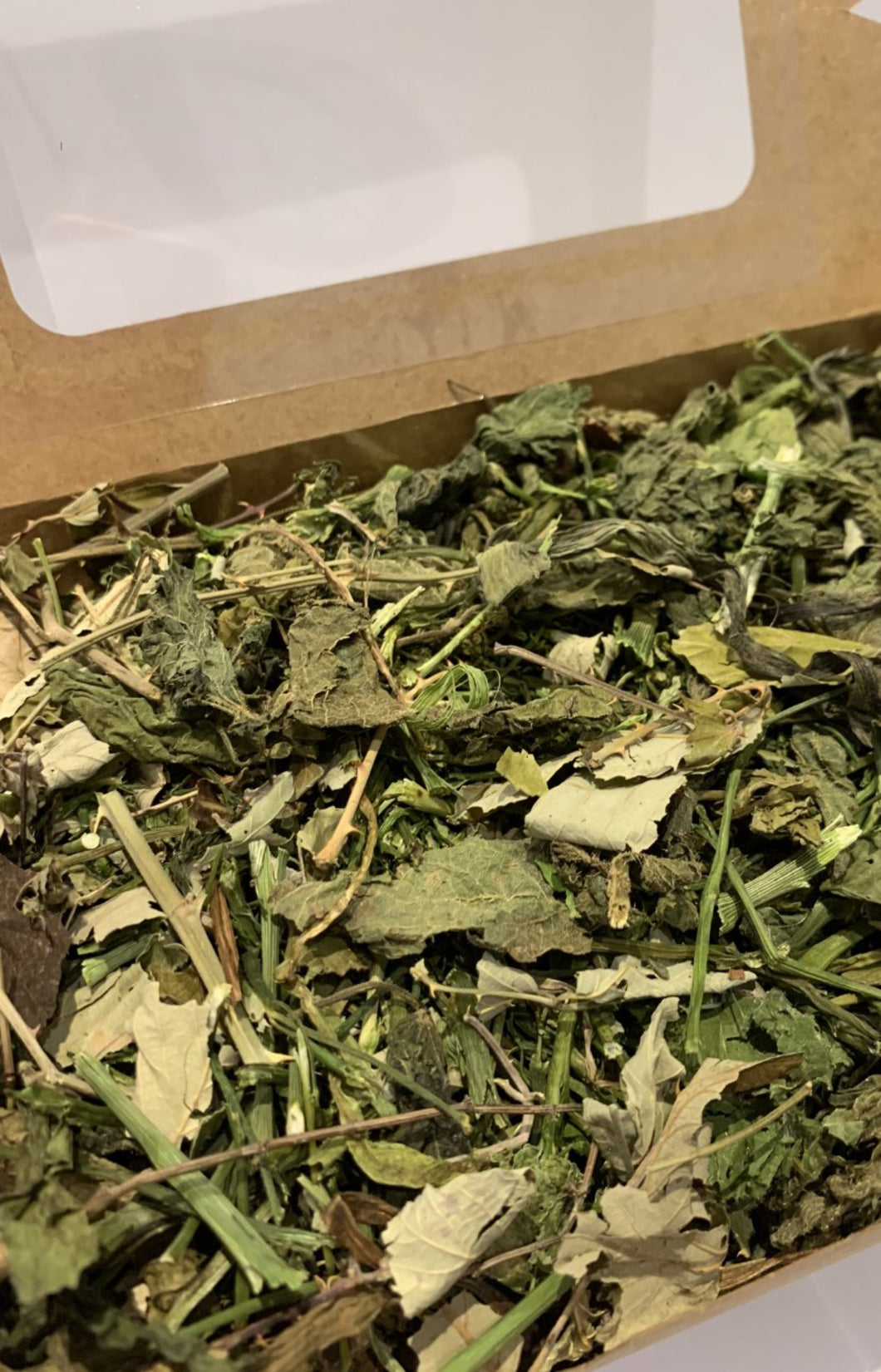 Box filled with healthy forage for rabbits
