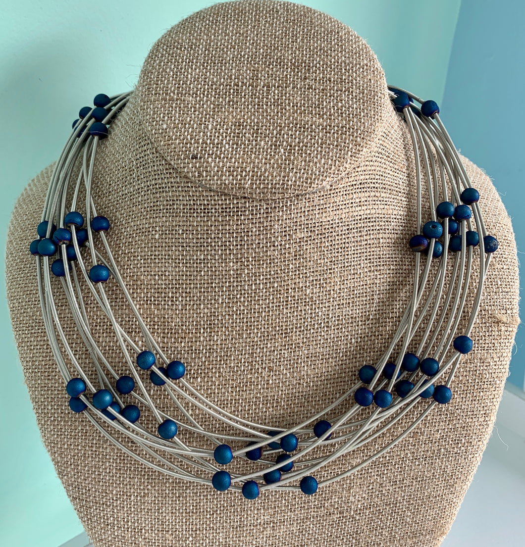 Sea Lily Piano 10 Layer Piano Wire and Blue Geode Necklace