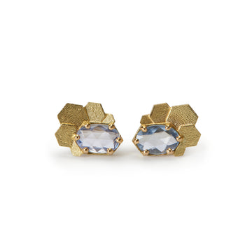 Chaos hex stud earrings with blue oval sapphires
