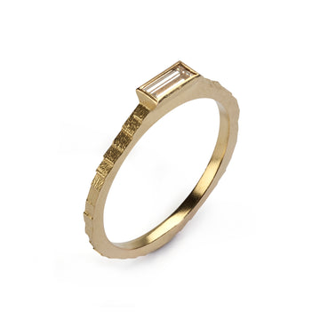 Single square band with baguette cut diamond