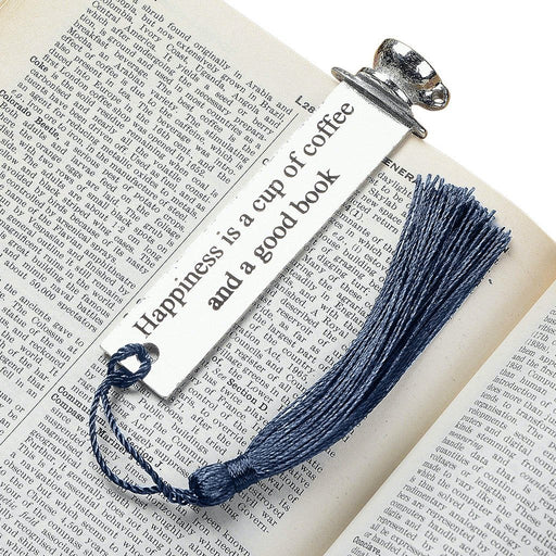bookmark with quotes by Judi Glover Art. The metal bookmark has the quote happiness is a cup of coffee and a good book. The metal bookmark is shown laying on a book.