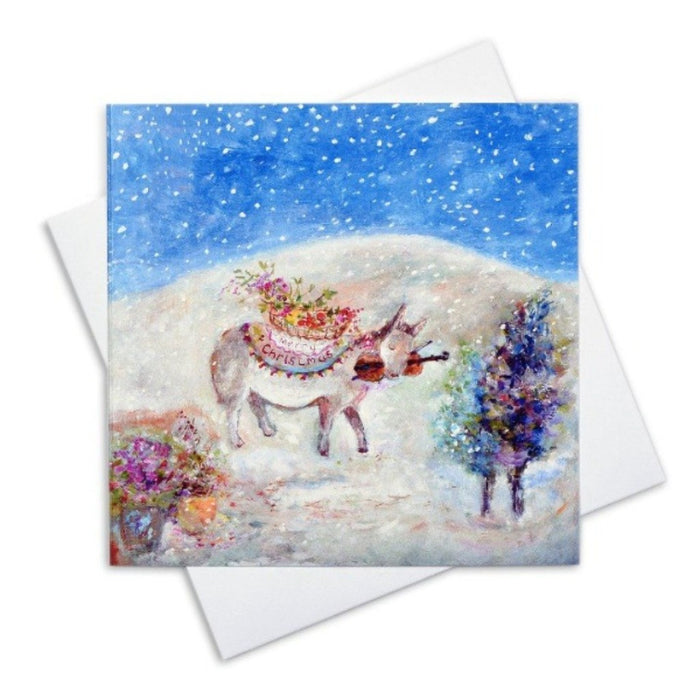 Art Christmas Cards by Judi Glover Art. Little Donkey Christmas Cards made from Fine Art in the UK. The painting of a little Donkey is by Judi Glover Art. The Art Christmas Card shows a Donkey in a Christmas Setting with snow falling and is available at Judi Glover Art.