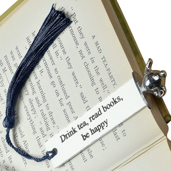 Tea lover gifts by Judi Glover Art. The tea lover metal bookmark is inscribed with drink tea, read books, be happy