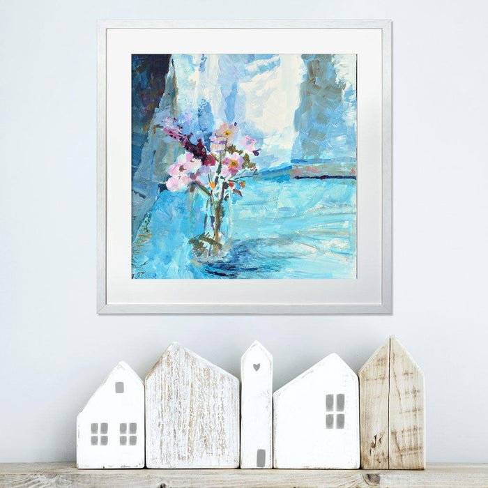 Wildflower Prints from a fine art painting of wildflowers surrounded by blue light by Judi Glover Art. The Flower Wall Art is printed on giclee paper and in a frame on a white wall above a shelf