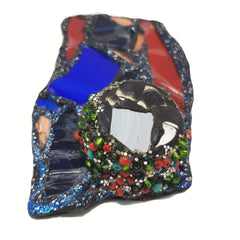 ANDREW LOGAN DESIGNER BROOCH featuring blue & red glass, mirror, beads and glitter.