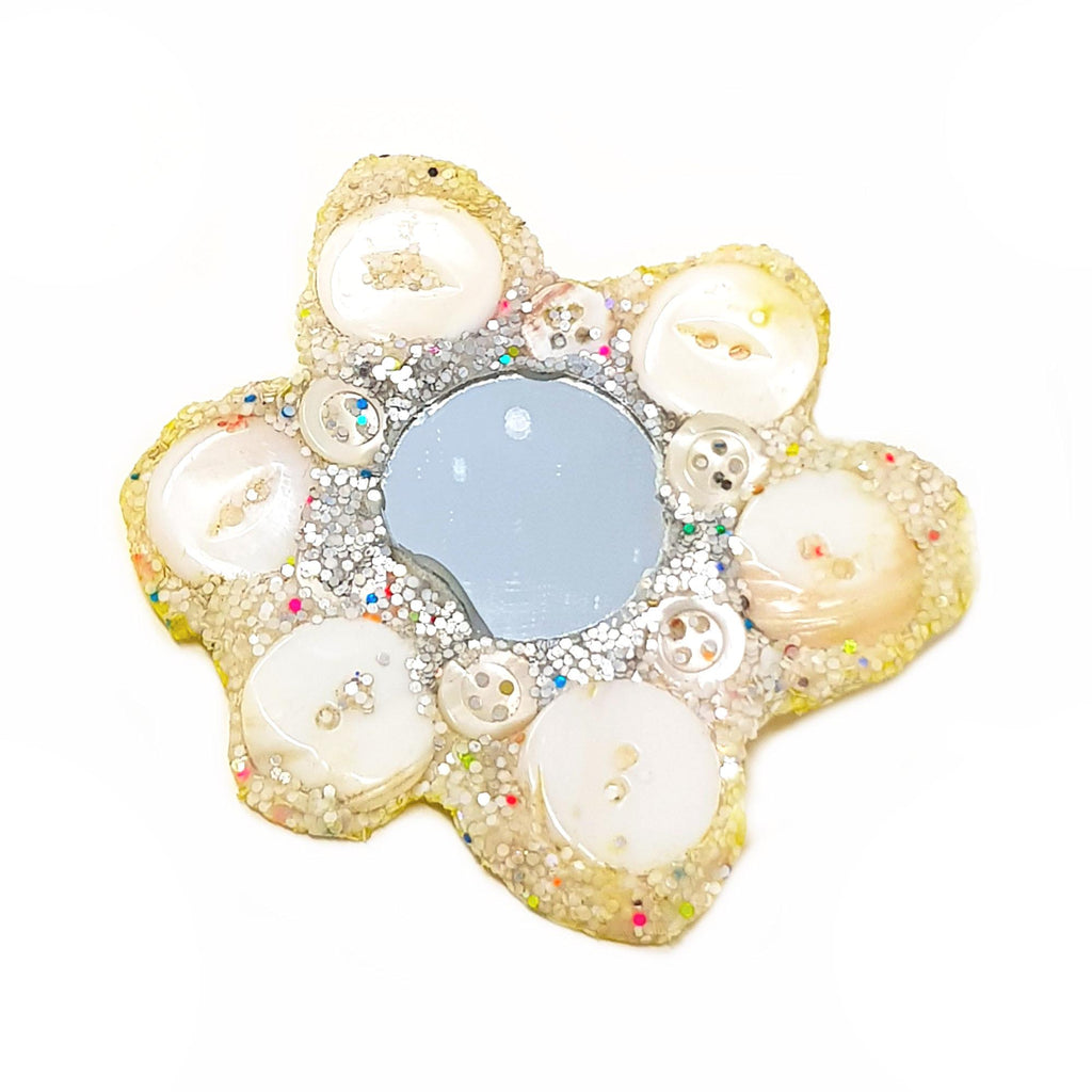 Andrew Logan White Flower Brooch, featuring buttons, mirror and glitter