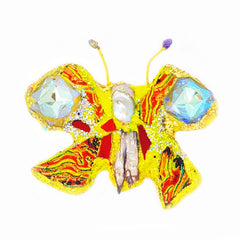 Yellow Butterfly brooch by Andrew Logan