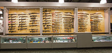 Gun Cradles gun display system for wall systems