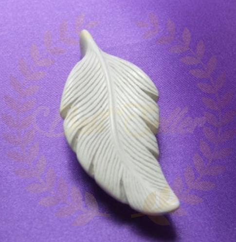Feather sculpture - Send to a Friend UK