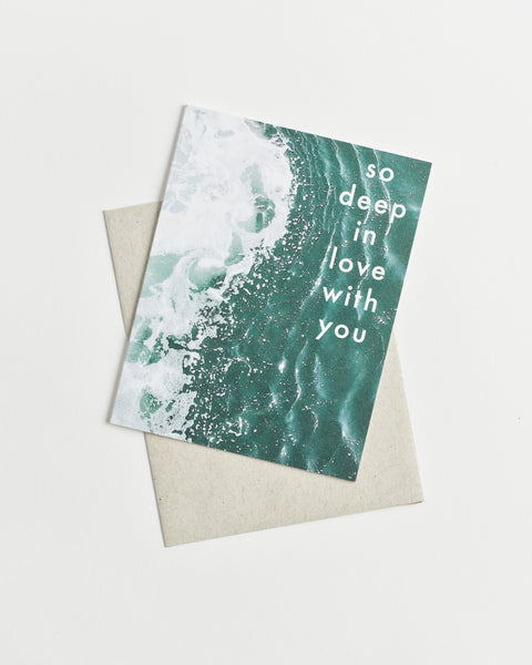 "Photo greeting card with deep teal ocean waters and ""So Deep in Love With You"" in white letters."