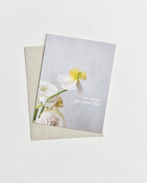 "Photo greeting card of a white and yellow flower and words ""so sorry for your loss"" in cursive."