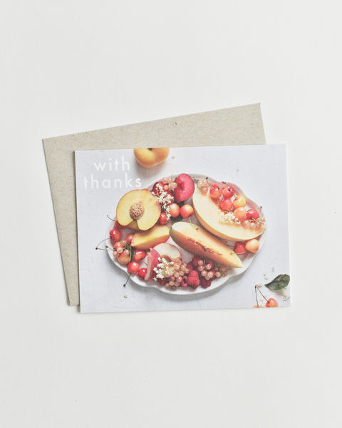 "Photo greeting card of a fruit bowl from above and words ""with thanks""."