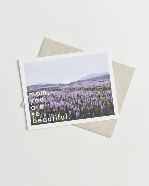"Photo greeting card of a field of purple flowers and words ""mom, you are so beautiful""."