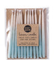 Package of 12 hand-dipped aqua color beeswax birthday candles with ombré effect