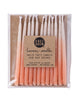 Package of 12 hand-dipped peach color beeswax birthday candles with ombré effect