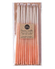 Package of 12 tall hand-dipped peach color beeswax birthday candles with ombré effect