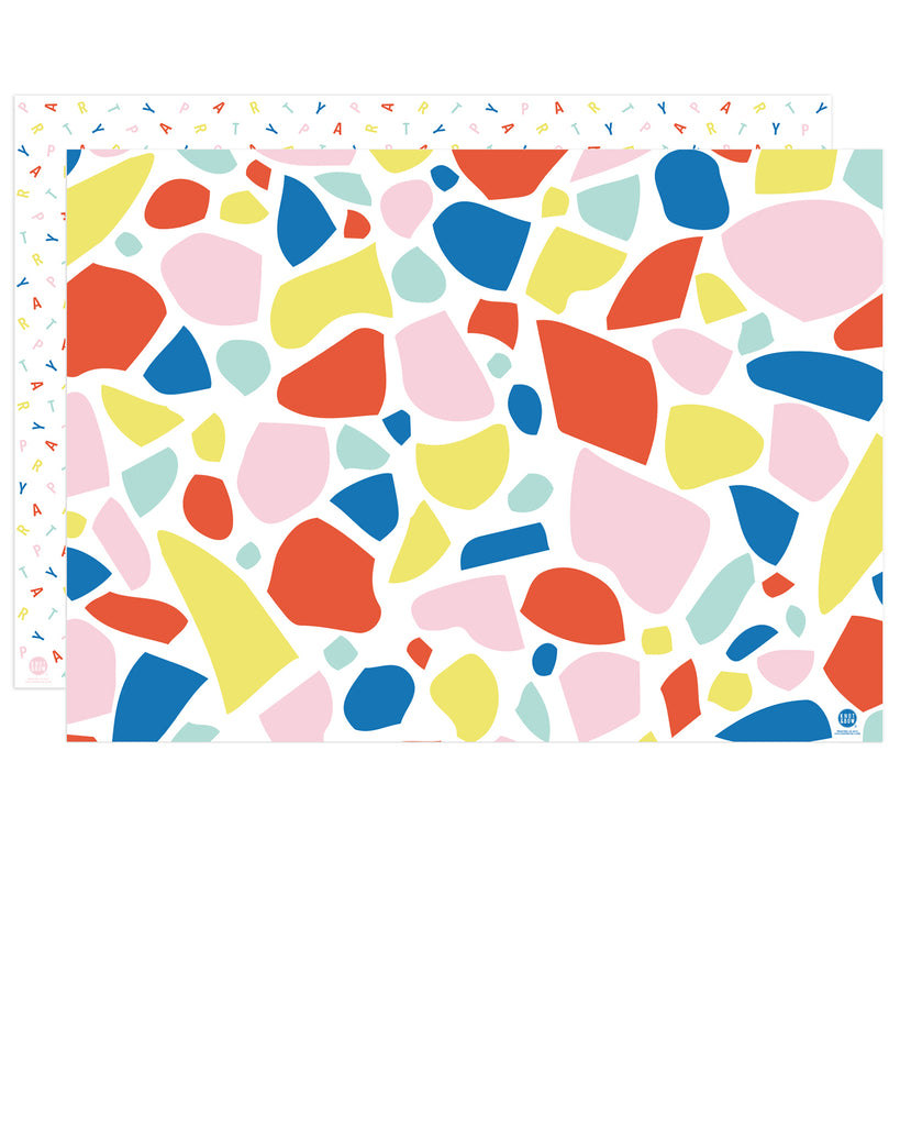 front and back of double-sided gift wrap in large rainbow chip and rainbow party scramble patterns