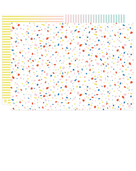 front and back of double-sided gift wrap in rainbow chip and rainbow gradient striped patterns