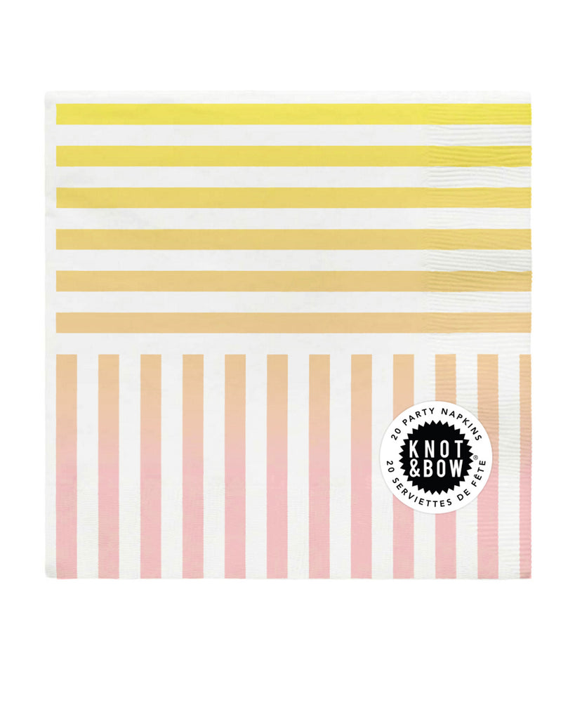 Package of 20 paper party napkins in rainbow gradient stripe pattern, showing pink, orange, and yellow gradient