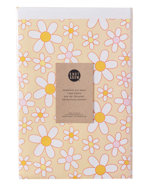 package of flat newsprint gift wrap in an daisy pattern
