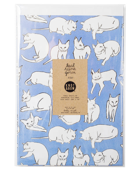 package of flat newsprint gift wrap in violet with a pattern of white cats