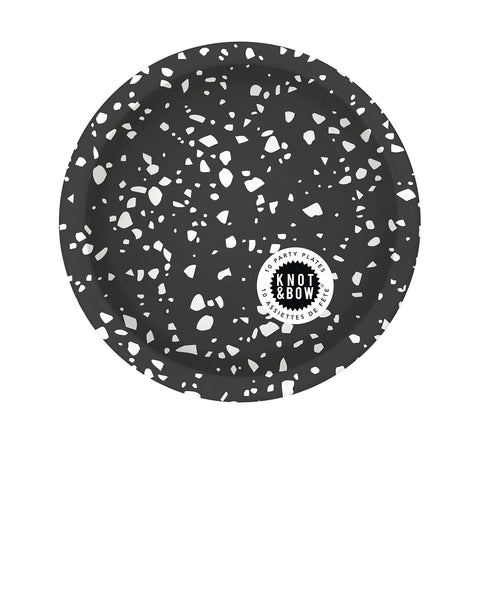 Package of 10 small paper party plates in black with a white chip pattern
