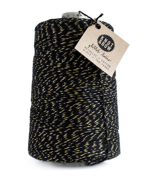 Jumbo cone with 750 yards of glitter twine in black cotton with a twist of metallic gold