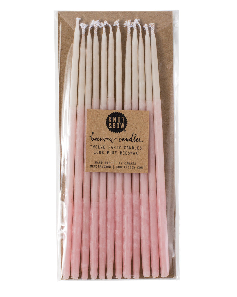 Package of 12 tall hand-dipped pink beeswax birthday candles with ombré effect